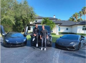 Jared Goetz, some guy, and expensive cars