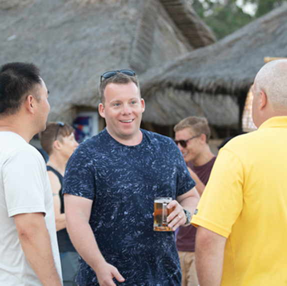 Anton Kraly socializing with students at the Drop Ship Lifestyle Retreat